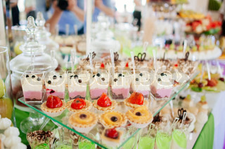 Different cakes on banquet table