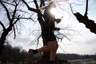Active sporty blond woman running