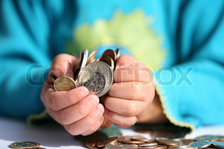 child holding   money in hands