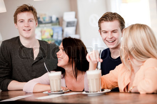Two young caucasian couples on a double date drinking cafe latte