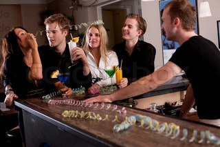 A group of young Europeans enjoying drinks in a bar