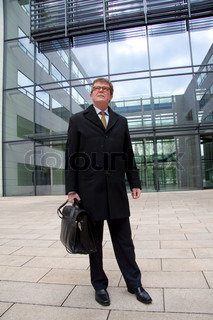 Business man in front of modern office building