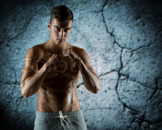 young man in fighting or boxing position
