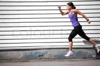 A young brunette caucasian woman in running sportswear