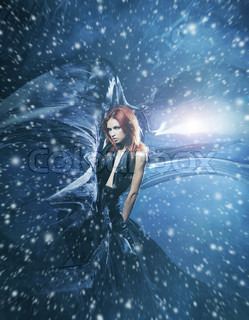 Young attractive woman in a blowing sil. Snowy background with wind, lighting and blizzard.