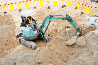 A digger in an excavation site