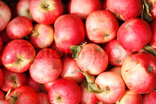 Red apples in wooden boxes