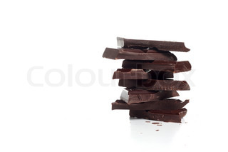Stack of chocolates on white background
