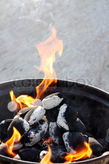 Charcoal in a barbeque grill