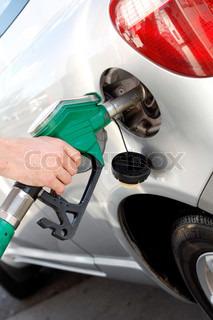 A man pumping gasoline into his car