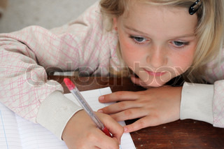 A young girl doing her homework