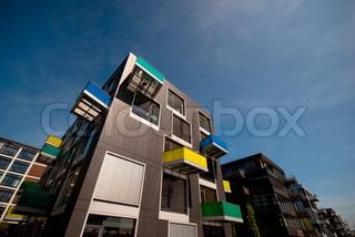 Modern steel facade with colourful balcony sky blue.