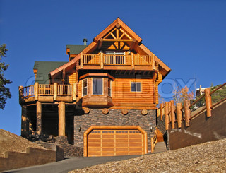 Log Cabin Home Exterior with Warm Fireplace ~ Perfect Vacation Getaway to Celebrate Xmas, the New Year or Winter Vacations.