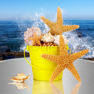 Day Spa Still-life Wtith Starfish And Sea Shells In Colorful Yellow Beach Bucket On White Glass Table