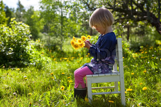 Young girl playing in garden