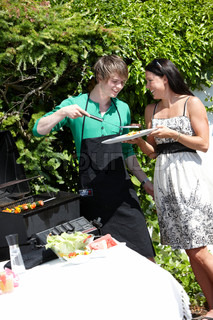 A young caucasian male cook reparing summer grill food