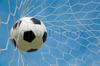 Soccer ball in the goal after shooted