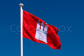 Flag of Hanseatic city, Hamburg in Germany. Sky blue and blowing in the wind.