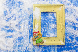 Gingerbread Christmas card. Christmas card with gingerbread and yellow frame
