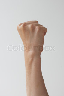 Hand gesturing sign language - making a fist