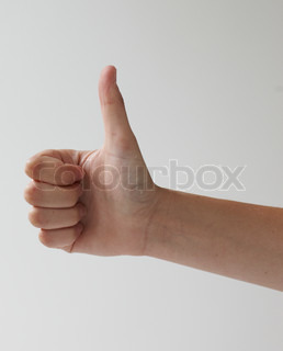 Hand gesturing sign language - thumb's up