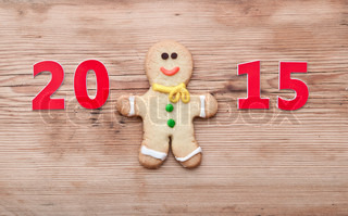 Christmas 2015 cookie with homemade christmas painted gingerbreads (gingerbread man and red boot) on the wooden background