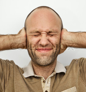 Man with eyes and ears tightly closed
