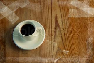 Kop kaffe på et træbord