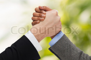 hands of two people arm wrestling