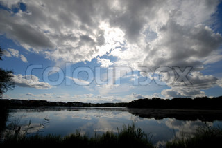 Scandinavian landscape with lake on a cloudy day