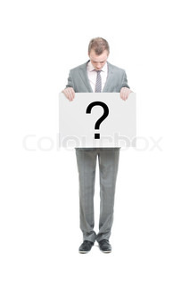 A business man holding a question mark