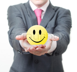 Businessman holding smiley
