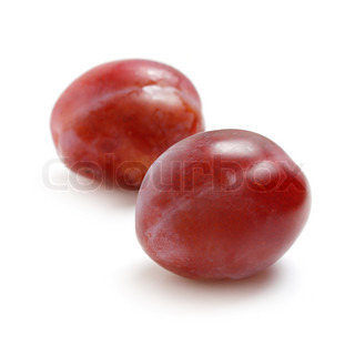 Two plums isolated on white