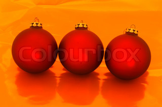 Red xmas baubles on a row