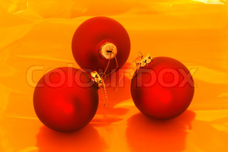 Christmas baubles on a golden surface