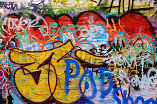 Graffitti wall covered with colourful tags