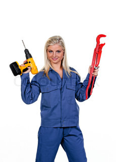 Young woman in blue work clothes with a drill