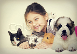 lovely girl and a group of pets