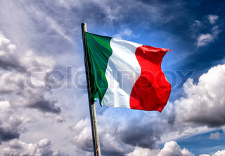 Italian three colors flag of Italy on the sunset sky background