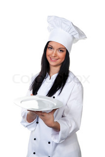 Young cook student tasting her meal