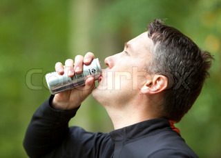 Drinks water after jogging