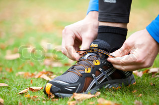 A man tying his running shoes