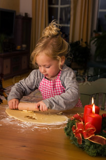 Child to bake Christmas cookies during Advent