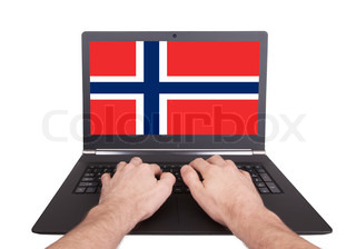 Hands working on laptop, Norway