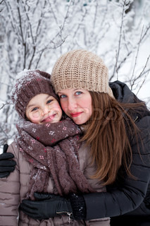 Winter portrait of a nine year girl with her mother