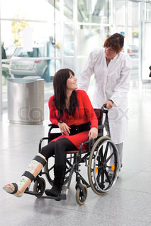 Young woman with a leg cast, wheelchair and nurse