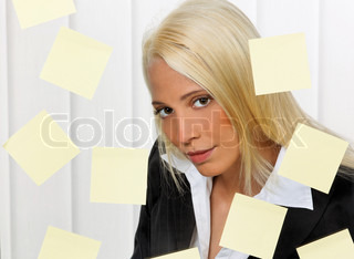 Stressed-out young woman with multiple assignments memos
