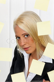 Young business woman with multiple assignments memos