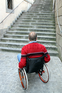 Middle-aged man with a walking disability seated in a wheelchair