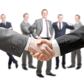 Businessmen in a group and a handshake
